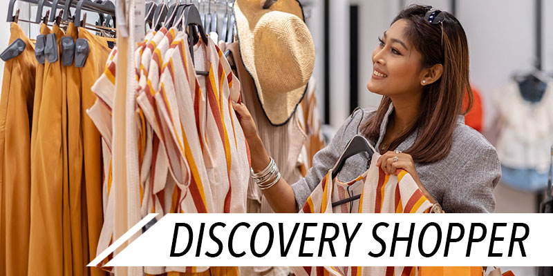 woman in store looking at clothing options